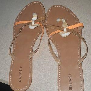 Never worn.  Size 11 nine west sandals
